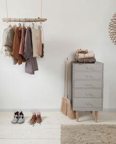 Minimal kids room with a beautiful handmade clothes hanger