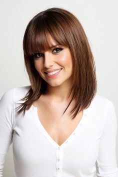 Cheryl Cole Lookbook: Cheryl Cole wearing Medium Straight Cut with Bangs (5 of 14). This is a classic straight cut, at medium length with bangs.