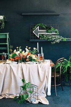 Summer Table Decorating Ideas black dining room with white tablecloth