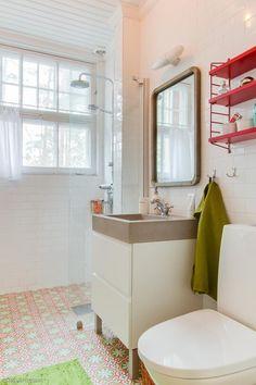 pretty floor tile, plain white tile on walls, red shelf