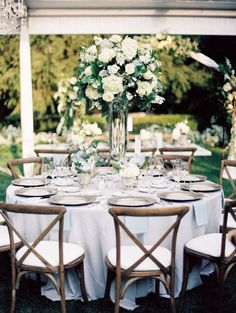 Classic + elegant wedding centerpiece idea - round, banquet tables with tall greenery + white flower centerpieces {The Creative Planners] #weddingcenterpieces