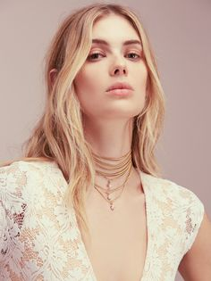 Delicate Chain Choker Bolo | Multi-layered snake chain metal bolo featuring different shaped charms. Adjustable lobster clasp closure.