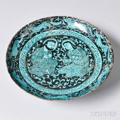 Turquoise and Black Kashan Plate, Persia, 13th/14th century. | Auction 2885B | Lot 9D | Sold for $20,910