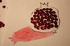 This pomegranate card for Rosh Hashanah fun for kids with good fine motor skills who enjoy glueing.  The sequins look gorgeous!