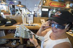 Carol Jensen at the Black Bear Diner displays a hat and eclipse glasses in Madras, Oregon on Saturday Eclipse Festival, Madras Oregon, Eclipse T Shirt, Southern Illinois, Total Eclipse, Grand Teton National Park, Once In A Lifetime, Black Bear, Hat
