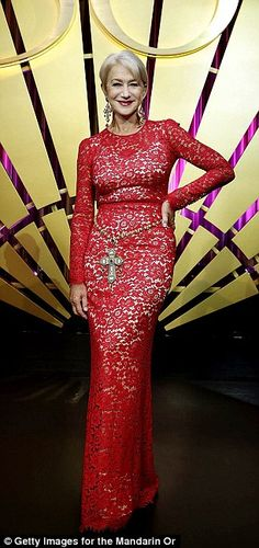 Helen Mirren looks just as good in a floor length red lace dress
