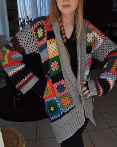 A granny square sweater with knitted borders.