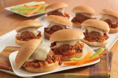 Baked Parmesan Meatball Sliders - What are sliders, really, but just tasty meatballs with hamburger fixings? Revel in the simplicity of it all with these tasty baked Parmesan bites.