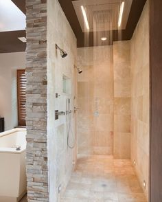 Example of a trendy double shower design. #travertinetiles