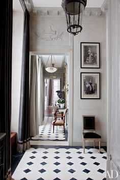 Curtained in a Romo velvet, a light-filled entrance hall greets visitors at a Paris apartment renovated and decorated by Deniot.