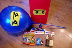 Creating fun Lego Ninjago Party Bags for the perfect birthday. Simple ideas to create a Lego Ninjago themed bag and contents.