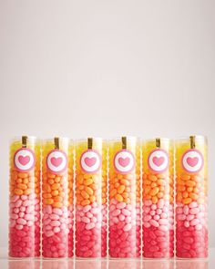 Baby Shower Favors: Clear tubes filled with jelly beans in gradient colors are simply way present this budget-friendly candy.