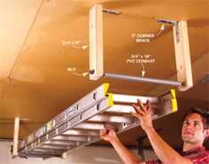 Hang ladders from the ceiling so they don't hog prime storage space. The rollers on this simple carriage let you easily slide in one end of the ladder, then the other. The materials you'll need cost about $20 at home centers.
