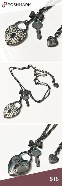 """Betsey Johnson Gunmetal Pave Heart Lock Necklace This is such a beautiful yet edgy necklace from Betsey Johnson - two strands of Gunmetal chain, the longer has the crystal pave heart, the shorter has the key. Not missing any crystals - where it's dark are little screws. Shorter strand is 19"""" and it has a 3"""" extender. In like-new condition. Questions? Please ask! Sorry, no trades. Bundle for a discount! Ships SAME day (EST) - New name brand jewelry added daily so check back often! Betsey…"""