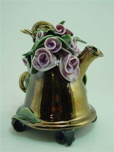 Porcelain teapot by Donna Causland. High temperature gold glaze & multiple fired.