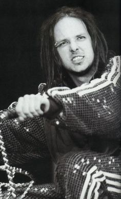 Jonathan Davis: whether rockin ass in a kilt or adidas tracksuit, this fucker rocked my world. LOVED him. Played Life is Peachy every day in the car on the way to school. :)