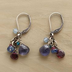 MOUNTAIN NIGHTS EARRINGS--The sun sets, dusk falls and snow-topped mountains glow—moments captured in handmade earrings of iolite, labradorite, rhodalite garnet, red and blue jade and Thai silver beads.