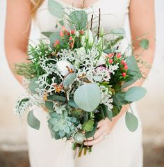 leafy green bouquet with succulents and eucalyptus
