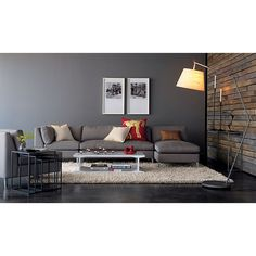 Dark floor, white shag rug, grey couch and wall