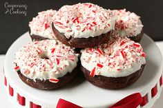 Light & fluffy chocolate donuts made from muffin mix topped with white chocolate candy coating and crushed candy canes. It's like having peppermint bark for breakfast!