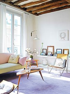 Love the tall beam ceilings and natural lighting.  Home of a French Fashion designer