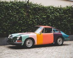 this porsche 1965 911 racer has been made over in paul smith's iconic stripes