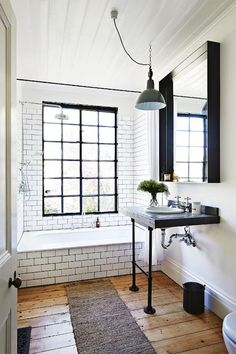 Gorgeous modern rustic bathroom with subway tiles & wood floors #homedecor #interiordesign