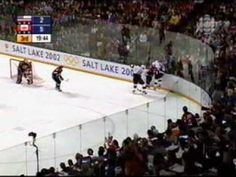 Fans sing O'Canada at the Gold Medal Olympic Hockey Game.  Salt Lake City 2002.