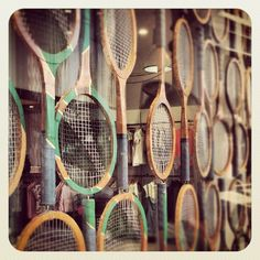 Wimbledon themed window display of wooden tennis racquets, Fred Perry