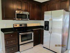 RM kitchen with dark cabinets