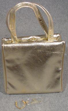 Vintage 1960s Miss Lewis Gold Handbag Purse Rhinestone closure. $30.00, via Etsy.