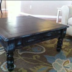 Coffee table. Mom found it at goodwill, then did this awesome distressing with black and blue. Perfect!