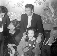 Some of the cast of the film 'The Leopard', including French actor Alain Delon, Italian actresses Claudia Cardinale (Claude Joséphine Rose Cardinale) and Rina Morelli (Elvira Morelli), American actor Burt Lancaster (Burton Stephen Lancaster) and Italian director Luchino Visconti (Luchino Visconti di Modrone conte di Lonate Pozzolo) being photographed by the photographers at the press conference for the film. Rome, 04/05/1962 Rome, Italy