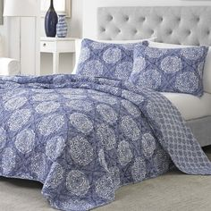 Add a pop of pattern to the master suite or guest room with this lovely quilt set, featuring a chic medallion motif.