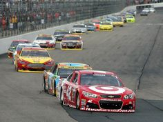 Kyle Larson (42), shown leading Kyle Busch (18) at