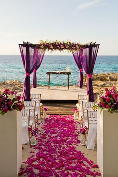 Purple Wedding Flowers Gorgeous wedding aisle decor - Manuela Stefan Photography - A Jamaica Destination Wedding Inspiration with tropical elegance vibes. The ceremony in shades of purple brings to life the Caribbean sea. Wedding Aisle Decorations, Beach Wedding Reception, Beach Ceremony, Wedding Ceremony, Wedding Venues, Night Beach Weddings, Church Wedding, Decor Wedding, Beach Wedding Gowns