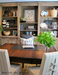 Home Office: Table used as desk || large rustic wall to wall bookcase with styled shelves