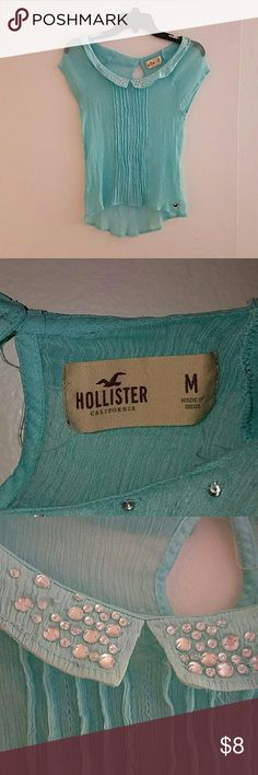 Hollister top Hollister bright sheer top, hi low in front,jeweled on the front collar, decorative lines in front small closure botton in the front, short sleeves. Decorative Lines, Hollister Tops, Fashion Design, Fashion Tips, Fashion Trends, Light Blue, Retail, Short Sleeves, Bright