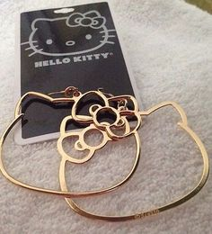 You know I gots these!Hello Kitty hoop earrings :) and like OMG! get some yourself some pawtastic adorable cat apparel! Hello Kitty Purse, Hello Kitty Jewelry, Hello Kitty Items, Kawaii Jewelry, Cat Jewelry, Jewelery, Kawaii Accessories, Hello Kitty Imagenes, Got Anime