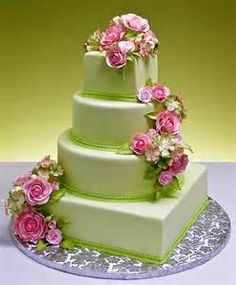 Love this cake colors! with flowers cascading down the cake