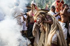 A Balinese man in a state of trance dances wearing a sacred Rangda mask during a sacred ritual of Ngusaba Puseh at Selumbung Village on September 11, 2014 in the Karangasem District, Bali, Indonesia. The Ngusaba Puseh ritual is performed once a year to celebrate the ancestors of the local community and show gratitude to God. (Photo by Agung Parameswara/Getty Images)
