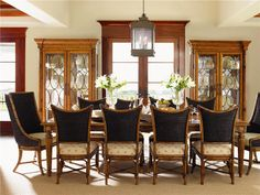 An eclectic mix of British Plantation and refined Caribbean styling, this formal dining set features the Grenadine Rectangular Dining Table, two Cruz Bay Host Chairs and eight Mangrove Side Chairs.