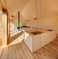 Timber House / KÜHNLEIN Architektur - Bavaria, Germany (2015) - Two gabled structures are unified with wooden lamellas: one containing living spaces and the other a series of bedrooms.