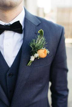 Luscious orange boutonniere | Image by Erin and Geoffrey Photography