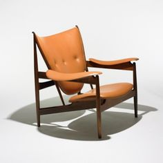 FINN JUHL    Chieftain chair    Niels Vodder  Denmark, 1949  rosewood, leather  41 w x 36 d x 37 h inches  Exhibited at the Cabinetmaker's Guild in Copenhagen in 1949, the Chieftain chair was named when King Frederik IX visited the exhibition and seated himself in the display model. This rosewood edition of the chair was produced in a limited edition of seventy-eight and was commissioned for the Danish consulates.