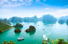 Vietnam-HALONG BAY Thousands of limestone karsts jut skyward from emerald waters in this UNESCO World Heritage-listed seascape. The best way to see it is to hop by boat between islands, including scenic Cat Ba, home to a national park.