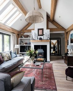 Vaulted ceilings are a wonderful device to add a wow factor to living areas. Explore how the homeowners of this single-storey oak-frame home created architectural drama and rebuffed the stigma of a boring retirement bungalow . Photo: Jeremy Phillips . #homebuilding #selfbuild #oakframe #bungalowidea #livingroom #livingroomideas #lifestyle #stove #interior #interiordesign #architecture #archilovers #pendantlight #modernrustic #cottagestyle #amazing #inspiration #home #idea