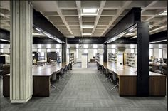 The original waffle ceiling has been retained, while a series of black frames run through between the columns, framing the reading desks for 'the gurus' AKA the researchers. Ceiling Ideas, Ceiling Design, Open Office, Office Spaces, Studio Interior, Interior Design, Waffle Ceiling, Brutalist Buildings, Coffer