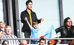 Noel Gallagher and a kid who looks just like him.