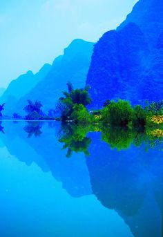 I'm totally into blue today... tomorrow I may be into green or rainbows - silhouettes in blue, Li River, China  photo via thepin